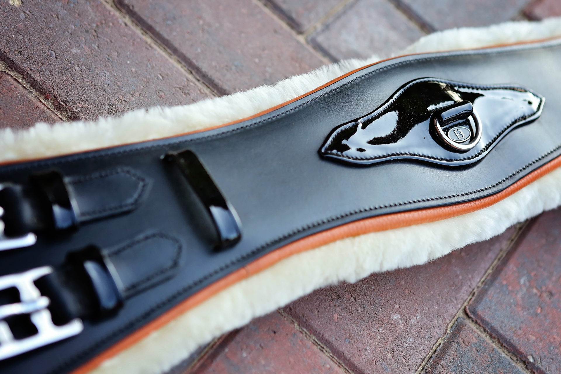Orange sheepskin leather girth